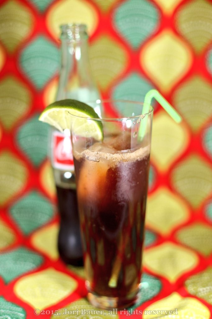 [Cuba Libre cocktail with straw and lime wedge; copyright 2015, Jorj Bauer, all rights reserved]